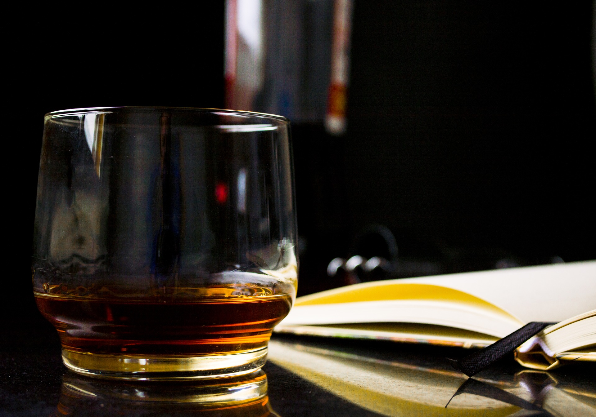 Knowledge Center - whiskey and book