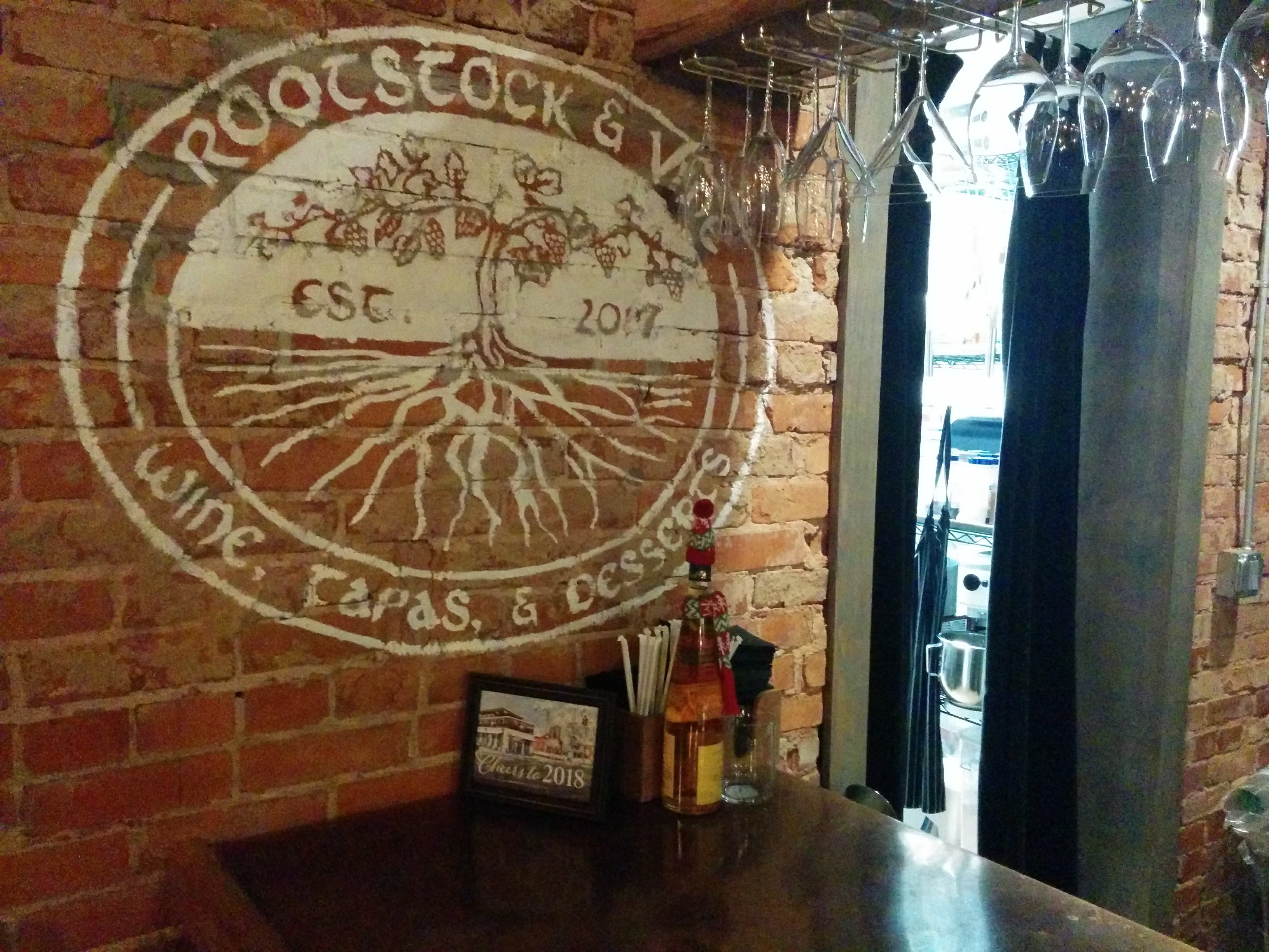 Rootstock and Vine brick wall logo